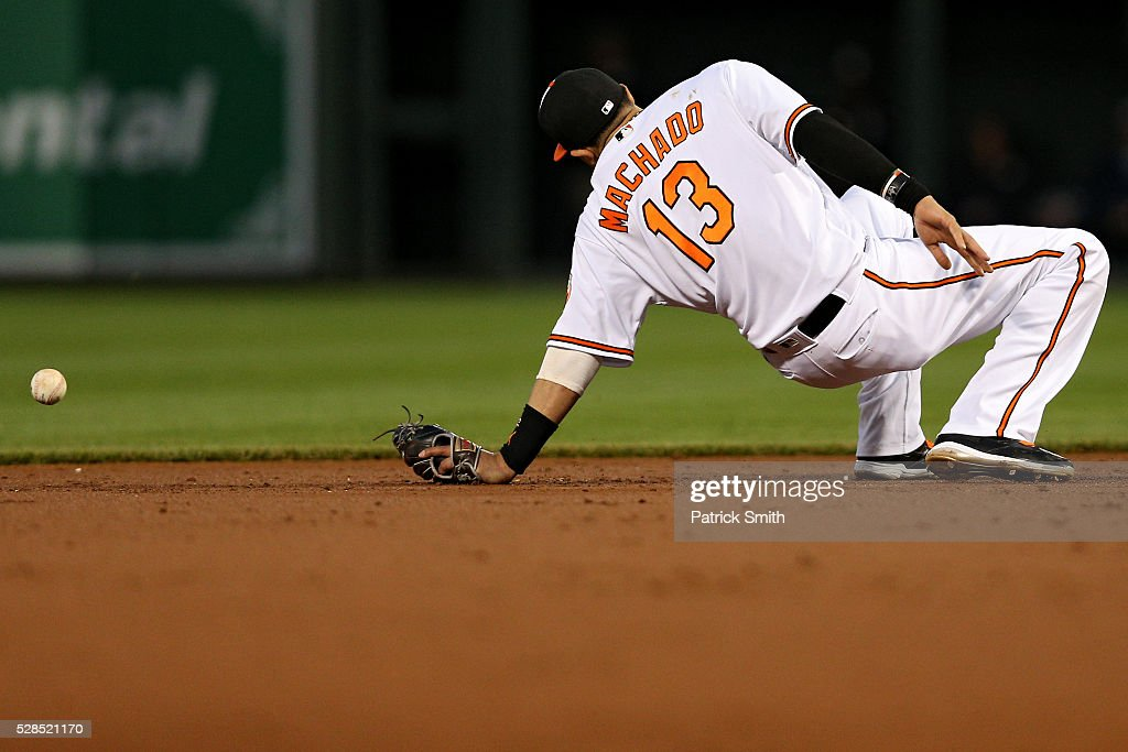 <a gi-track='captionPersonalityLinkClicked' href=/galleries/search?phrase=Manny+Machado&family=editorial&specificpeople=5591039 ng-click='$event.stopPropagation()'>Manny Machado</a> #13 of the Baltimore Orioles cannot grab a hit by Aaron Hicks #31 of the New York Yankees (not pictured) in the third inning at Oriole Park at Camden Yards on May 5, 2016 in Baltimore, Maryland.