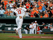Manny Machado of the Baltimore Orioles celebrates after hitting a solo home run against the Philadelphia Phillies in the first inning at Oriole Park...