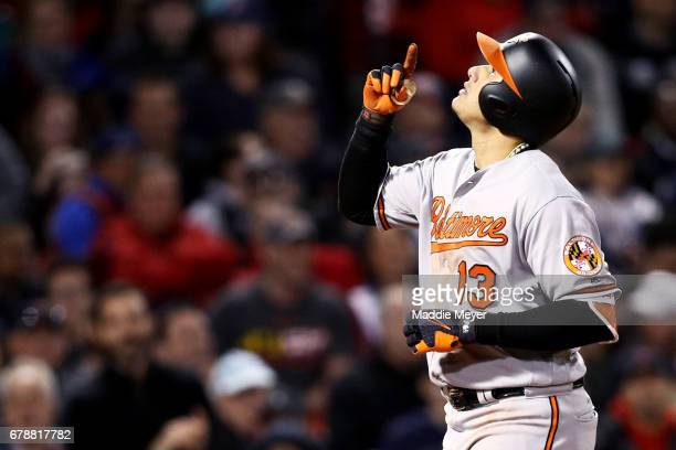 Manny Machado of the Baltimore Orioles celebrates after hitting a threerun homer against the Boston Red Sox during the fourth inning at Fenway Park...