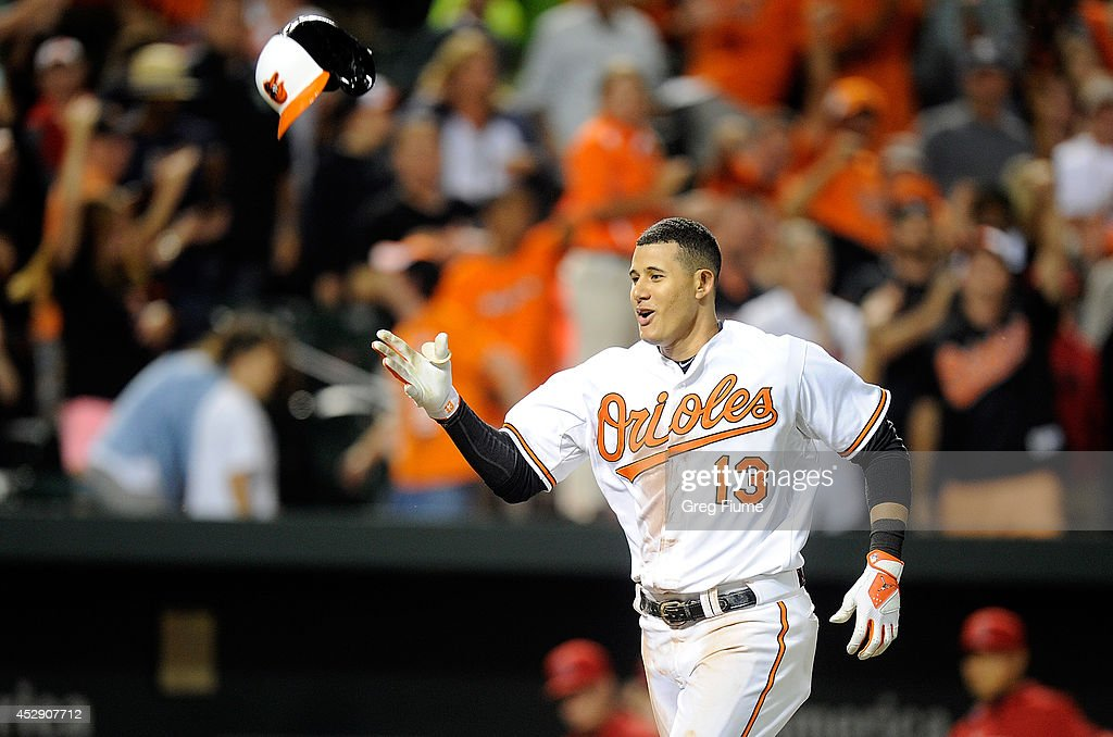 <a gi-track='captionPersonalityLinkClicked' href=/galleries/search?phrase=Manny+Machado&family=editorial&specificpeople=5591039 ng-click='$event.stopPropagation()'>Manny Machado</a> #13 of the Baltimore Orioles celebrates after hitting the game winning home run in the 12th inning against the Los Angeles Angels of Anaheim at Oriole Park at Camden Yards on July 29, 2014 in Baltimore, Maryland. Baltimore won the game 7-6.