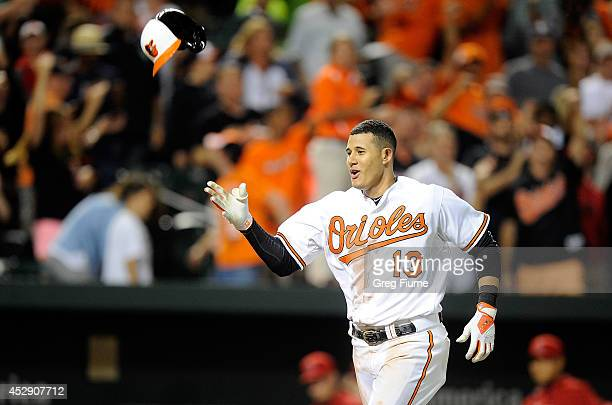 Manny Machado of the Baltimore Orioles celebrates after hitting the game winning home run in the 12th inning against the Los Angeles Angels of...