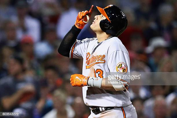 Manny Machado of the Baltimore Orioles celebrates after scoring a home run against the Boston Red Sox during the fourth inning at Fenway Park on...