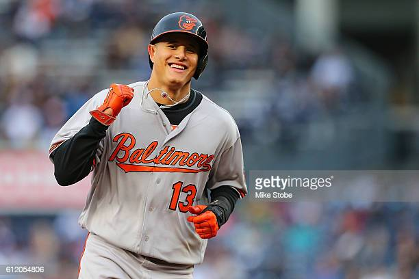 Manny Machado of the Baltimore Orioles celebrates Matt Wieters second tworun home run of the game as he rounds second base in the sixth inning...