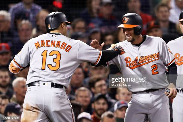 Manny Machado of the Baltimore Orioles celebrates with JJ Hardy after hitting a threerun homer during the fourth inning against the Boston Red Sox at...