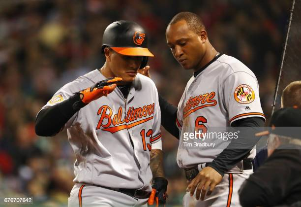Manny Machado of the Baltimore Orioles celebrates with Jonathan Schoop after hitting a solo home run during the seventh inning against the Boston Red...