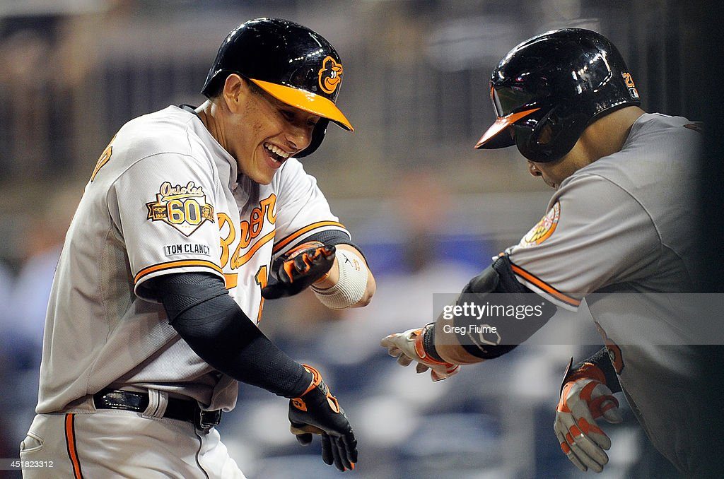 <a gi-track='captionPersonalityLinkClicked' href=/galleries/search?phrase=Manny+Machado&family=editorial&specificpeople=5591039 ng-click='$event.stopPropagation()'>Manny Machado</a> #13 of the Baltimore Orioles celebrates with <a gi-track='captionPersonalityLinkClicked' href=/galleries/search?phrase=Nelson+Cruz&family=editorial&specificpeople=235459 ng-click='$event.stopPropagation()'>Nelson Cruz</a> #23 after hitting a home run in the eleventh inning against the Washington Nationals at Nationals Park on July 7, 2014 in Washington, DC. Baltimore won the game 8-2.