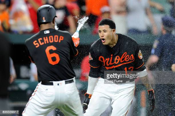 Manny Machado of the Baltimore Orioles celebrates with teammates after hitting the game winning grand slam in the ninth inning against the Los...