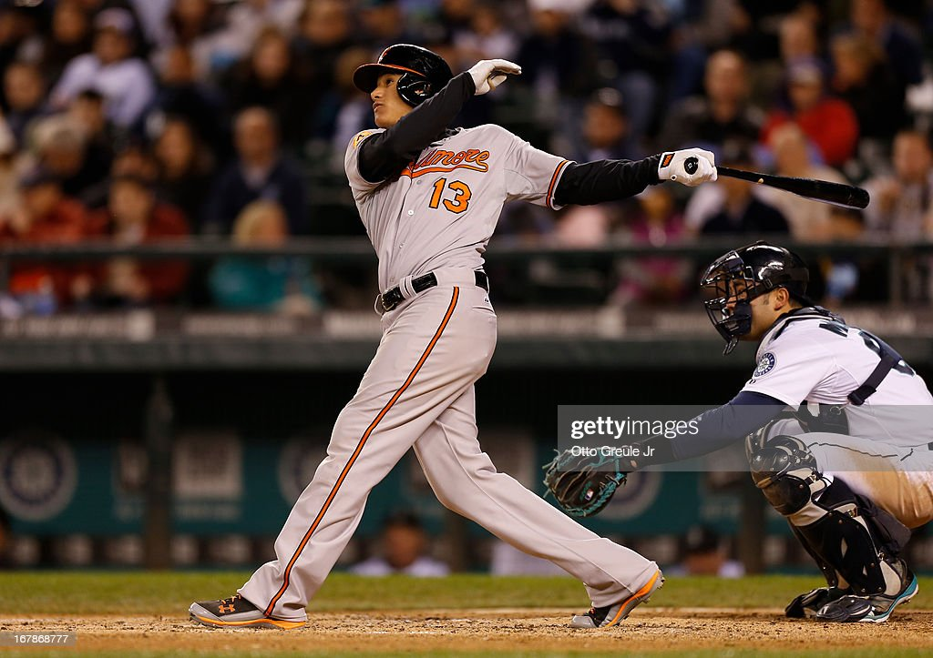 <a gi-track='captionPersonalityLinkClicked' href=/galleries/search?phrase=Manny+Machado&family=editorial&specificpeople=5591039 ng-click='$event.stopPropagation()'>Manny Machado</a> #13 of the Baltimore Orioles doubles against the Seattle Mariners in the sixth inning at Safeco Field on May 1, 2013 in Seattle, Washington.