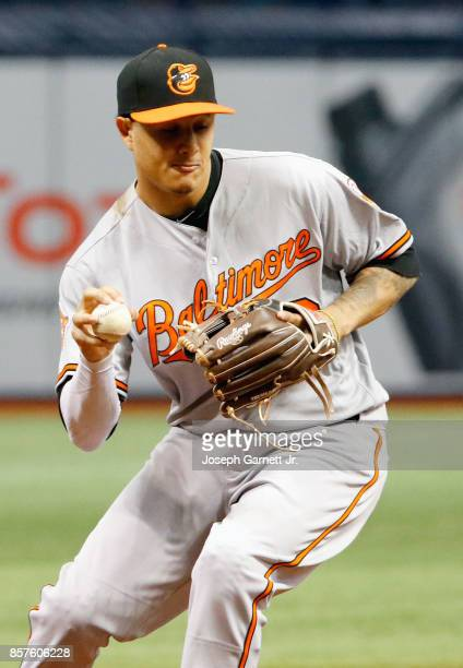 Manny Machado of the Baltimore Orioles fields a ground ball with his bare hand before throwing the runner out in the bottom of the second inning of...