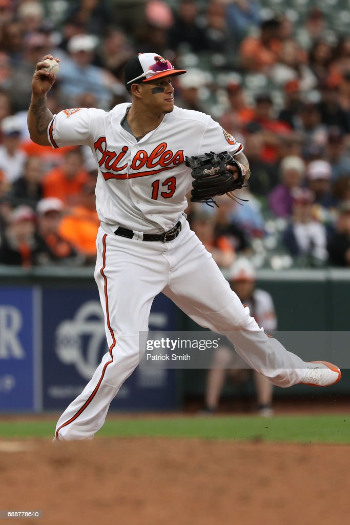 Manny Machado #13 of the Baltimore Orioles fields against the Minnesota Twins at Oriole Park at Camden Yards on May 24, 2017 in Baltimore, Maryland.