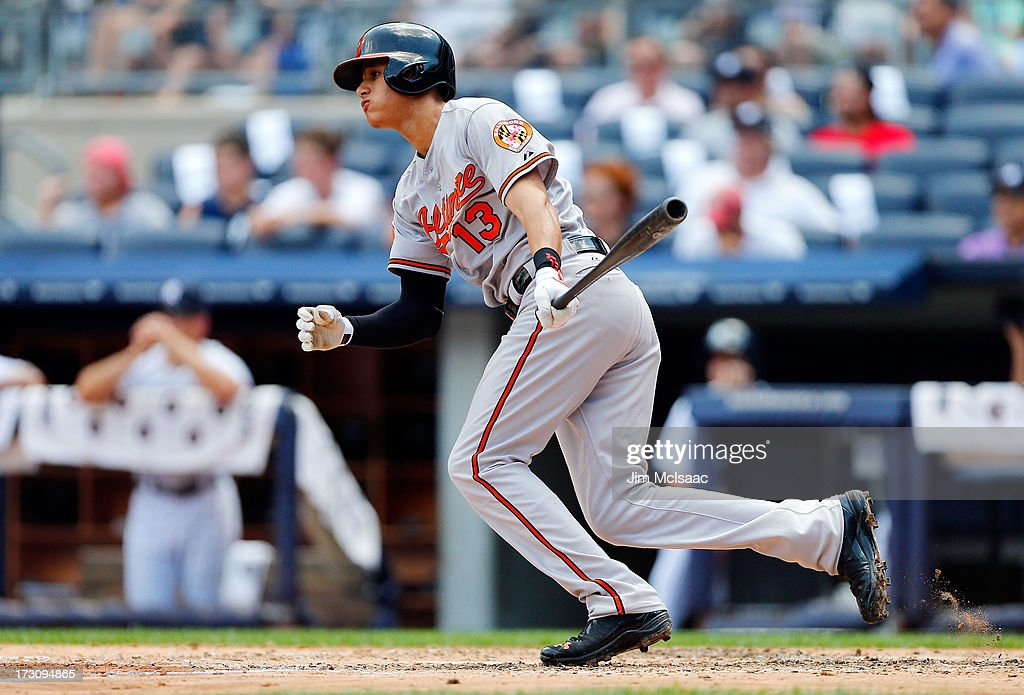 <a gi-track='captionPersonalityLinkClicked' href=/galleries/search?phrase=Manny+Machado&family=editorial&specificpeople=5591039 ng-click='$event.stopPropagation()'>Manny Machado</a> #13 of the Baltimore Orioles follows through on a third inning double against the New York Yankees at Yankee Stadium on July 6, 2013 in the Bronx borough of New York City.