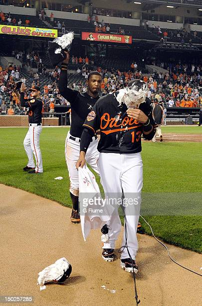 Manny Machado of the Baltimore Orioles gets a shaving cream pie by Adam Jones after a 71 victory against the Kansas City Royals at Oriole Park at...