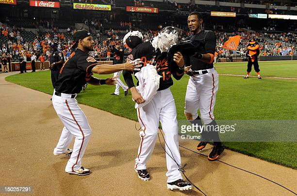 Manny Machado of the Baltimore Orioles gets a shaving cream pie by Robert Andino and Adam Jones after a 71 victory against the Kansas City Royals at...