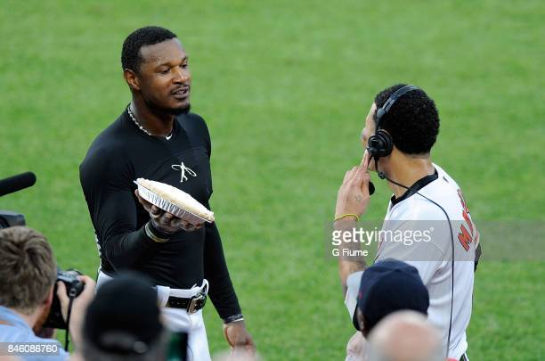 Manny Machado of the Baltimore Orioles gets pied by Adam Jones after hitting the game winning home run in the 12th inning against the Oakland...