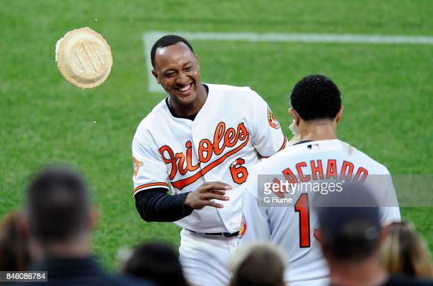 Manny Machado of the Baltimore Orioles gets pied by Jonathan Schoop after hitting the game winning home run in the 12th inning against the Oakland...