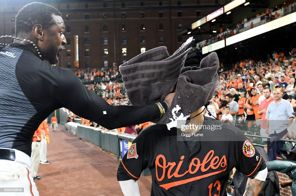 Manny Machado #13 of the Baltimore Orioles gets shaving creamed by Adam Jones #10 after hitting the game winning grand slam in the ninth inning against the Los Angeles Angels at Oriole Park at Camden Yards on August 18, 2017 in Baltimore, Maryland. Baltimore won the game 9-7.