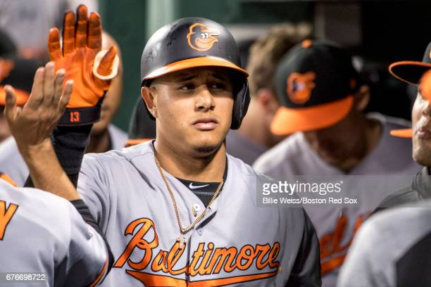 Manny Machado of the Baltimore Orioles high fives teammates after hitting a solo home run during the seventh inning of a game against the Boston Red...