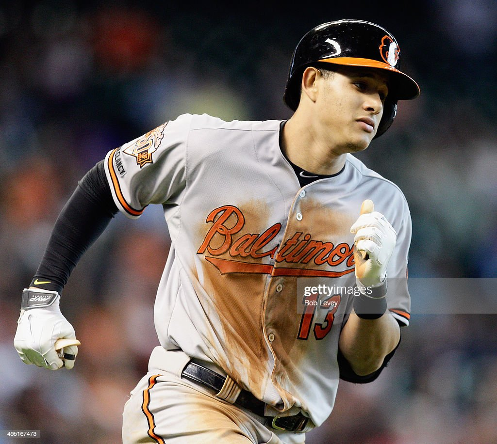 <a gi-track='captionPersonalityLinkClicked' href=/galleries/search?phrase=Manny+Machado&family=editorial&specificpeople=5591039 ng-click='$event.stopPropagation()'>Manny Machado</a> #13 of the Baltimore Orioles hit a grand slam in the sixth inning against the Houston Astros at Minute Maid Park on June 1, 2014 in Houston, Texas.