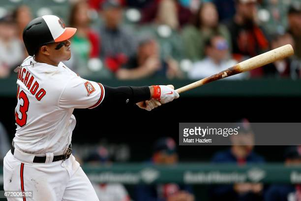 Manny Machado of the Baltimore Orioles hits a double onerun RBI against the Boston Red Sox in the eighth inning at Oriole Park at Camden Yards on...