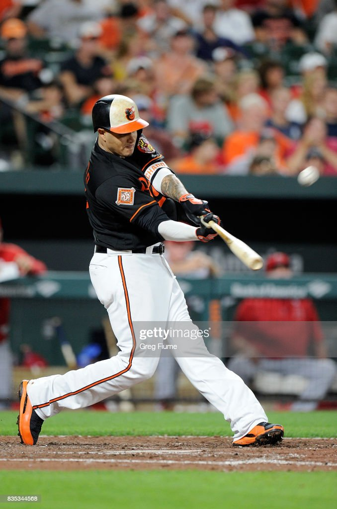 Manny Machado #13 of the Baltimore Orioles hits a home run in the fifth inning against the Los Angeles Angels at Oriole Park at Camden Yards on August 18, 2017 in Baltimore, Maryland. Baltimore won the game 9-7.