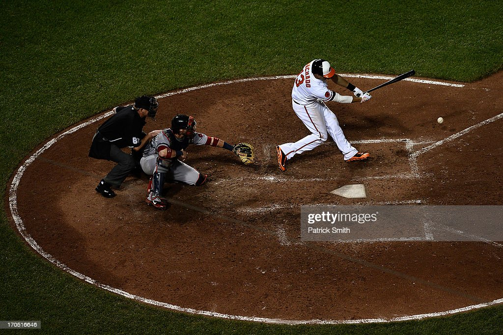 <a gi-track='captionPersonalityLinkClicked' href=/galleries/search?phrase=Manny+Machado&family=editorial&specificpeople=5591039 ng-click='$event.stopPropagation()'>Manny Machado</a> #13 of the Baltimore Orioles hits a single against the Boston Red Sox in the sixth inning at Oriole Park at Camden Yards on June 13, 2013 in Baltimore, Maryland. The Baltimore Orioles won, 5-4, in 13-innings.