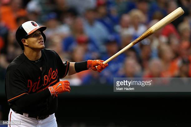 Manny Machado of the Baltimore Orioles hits a single in the third inning against the Toronto Blue Jays at Oriole Park at Camden Yards on June 17 2016...