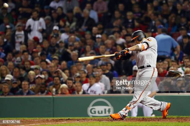 Manny Machado of the Baltimore Orioles hits a solo home run during the seventh inning against the Boston Red Sox at Fenway Park on May 2 2017 in...