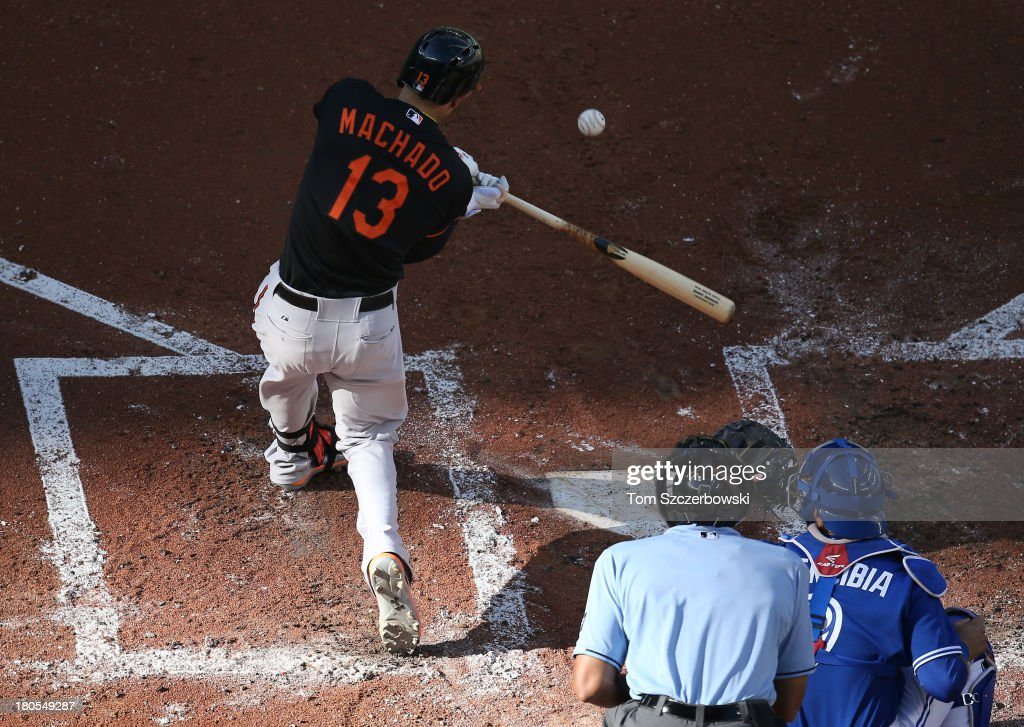 <a gi-track='captionPersonalityLinkClicked' href=/galleries/search?phrase=Manny+Machado&family=editorial&specificpeople=5591039 ng-click='$event.stopPropagation()'>Manny Machado</a> #13 of the Baltimore Orioles hits a solo home run in the third inning during MLB game action against the Toronto Blue Jays on September 14, 2013 at Rogers Centre in Toronto, Ontario, Canada.