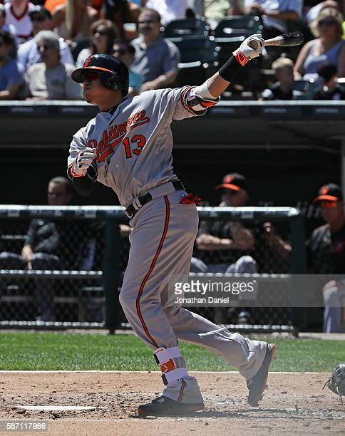 Manny Machado of the Baltimore Orioles hits a three run home run in the 2nd inning against the Chicago White Sox at US Cellular Field on August 7...