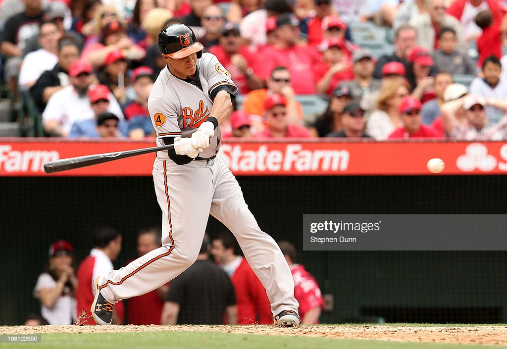 <a gi-track='captionPersonalityLinkClicked' href=/galleries/search?phrase=Manny+Machado&family=editorial&specificpeople=5591039 ng-click='$event.stopPropagation()'>Manny Machado</a> #13 of the Baltimore Orioles hits a two run home run in the fifth inning against the Los Angeles Angels of Anaheim at Angel Stadium of Anaheim on May 5, 2013 in Anaheim, California. The Orioles won 8-4.