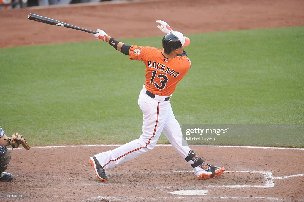 <a gi-track='captionPersonalityLinkClicked' href=/galleries/search?phrase=Manny+Machado&family=editorial&specificpeople=5591039 ng-click='$event.stopPropagation()'>Manny Machado</a> #13 of the Baltimore Orioles hits a two-run home run in the eighth inning during a baseball game against the Tampa Bay Rays on June 28, 2014 at Oriole Park at Camden Yards in Baltimore, Maryland. The Rays won 5-4.