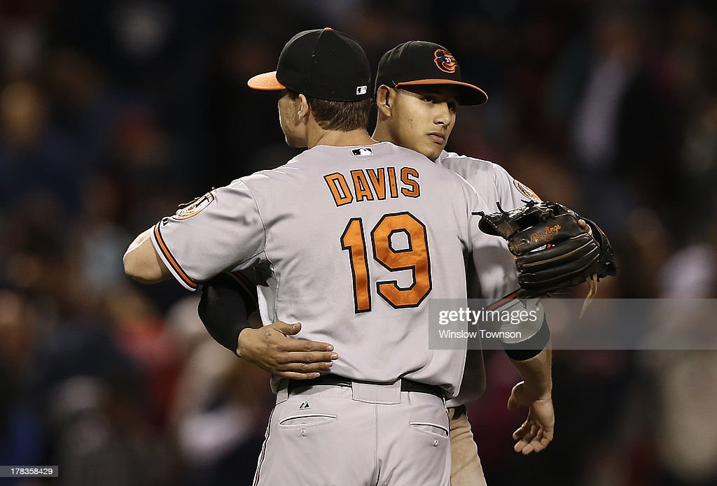<a gi-track='captionPersonalityLinkClicked' href=/galleries/search?phrase=Manny+Machado&family=editorial&specificpeople=5591039 ng-click='$event.stopPropagation()'>Manny Machado</a> #13 of the Baltimore Orioles hugs teammate Chris Davis #19 of the Baltimore Orioles after their 3-2 win over the Boston Red Sox at Fenway Park on Aug. 29, 2013 in Boston, Massachusetts.