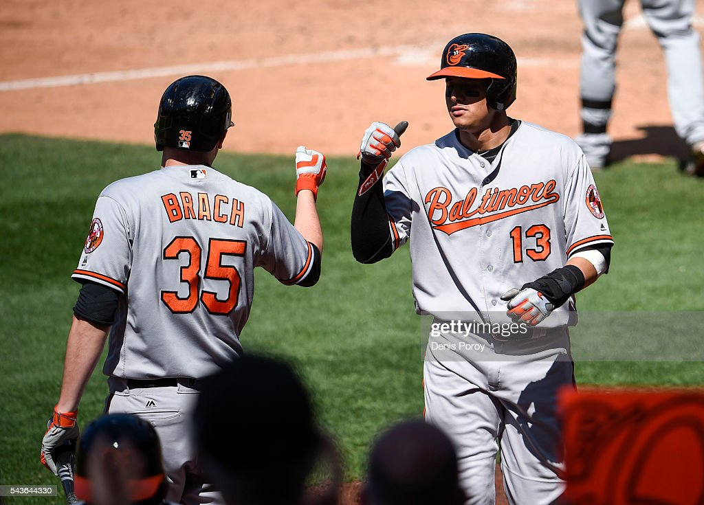 <a gi-track='captionPersonalityLinkClicked' href=/galleries/search?phrase=Manny+Machado&family=editorial&specificpeople=5591039 ng-click='$event.stopPropagation()'>Manny Machado</a> #13 of the Baltimore Orioles is congratulated by Brad Brach #35 after scoring during the ninth inning of a baseball game against the San Diego Padres at PETCO Park on June 29, 2016 in San Diego, California.