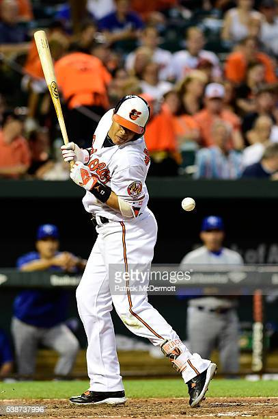 Manny Machado of the Baltimore Orioles is hit by a pitch thrown by Yordano Ventura of the Kansas City Royals in the fifth inning during a MLB...