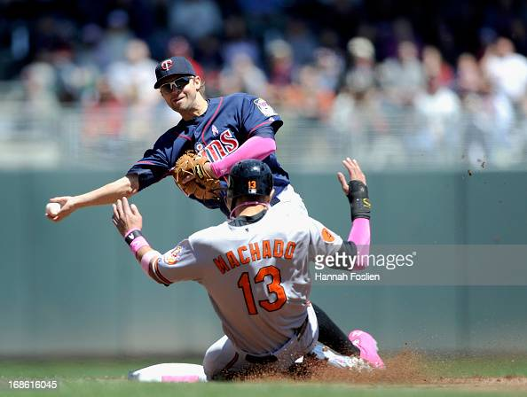 Manny Machado of the Baltimore Orioles is out at second base as Brian Dozier of the Minnesota Twins turns a double play during the first inning of...