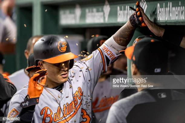 Manny Machado of the Baltimore Orioles is sprayed with sunflower seeds as he high fives teammates after hitting a solo home run during the seventh...