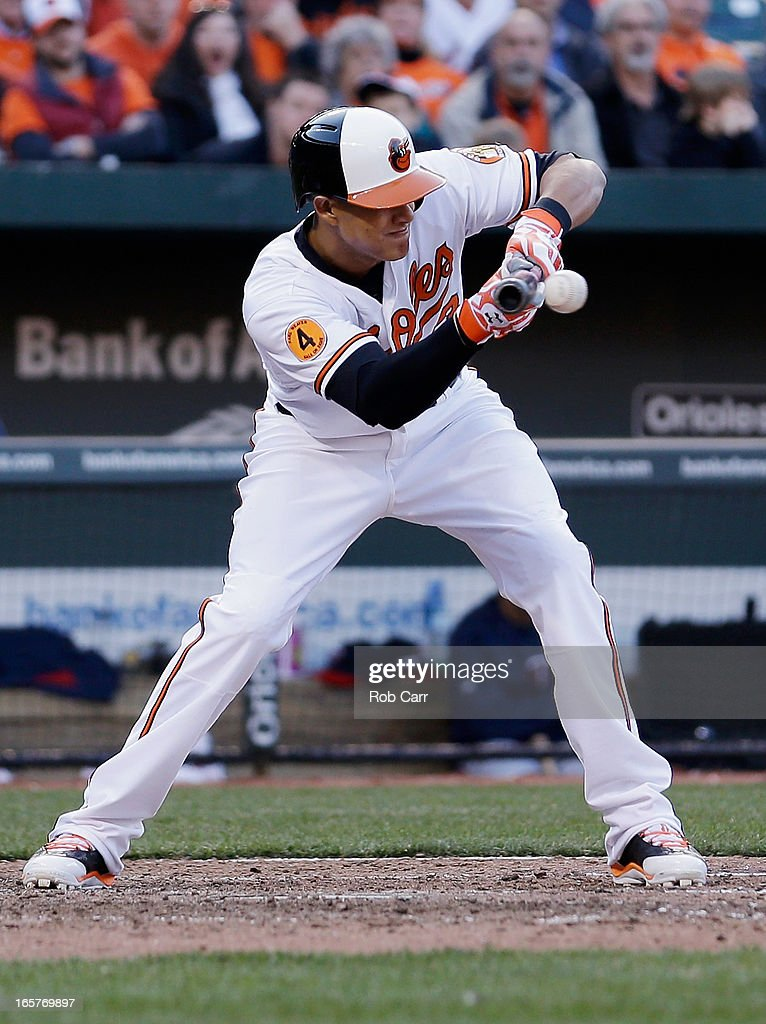 <a gi-track='captionPersonalityLinkClicked' href=/galleries/search?phrase=Manny+Machado&family=editorial&specificpeople=5591039 ng-click='$event.stopPropagation()'>Manny Machado</a> #13 of the Baltimore Orioles lays down a bunt against the Minnesota Twins during the eighth inning of their opening day game at Oriole Park at Camden Yards on April 5, 2013 in Baltimore, Maryland.