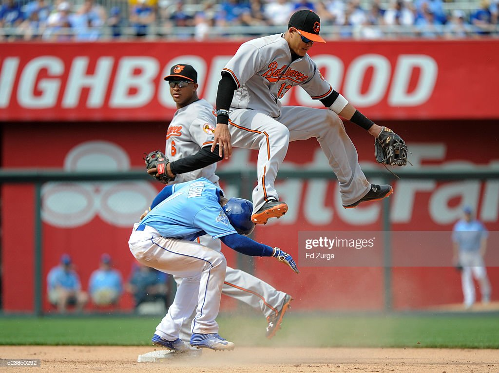 <a gi-track='captionPersonalityLinkClicked' href=/galleries/search?phrase=Manny+Machado&family=editorial&specificpeople=5591039 ng-click='$event.stopPropagation()'>Manny Machado</a> #13 of the Baltimore Orioles leaps over <a gi-track='captionPersonalityLinkClicked' href=/galleries/search?phrase=Jarrod+Dyson&family=editorial&specificpeople=6780110 ng-click='$event.stopPropagation()'>Jarrod Dyson</a> #1 of the Kansas City Royals as he gets the force out in the eighth inning at Kauffman Stadium on April 24, 2016 in Kansas City, Missouri.