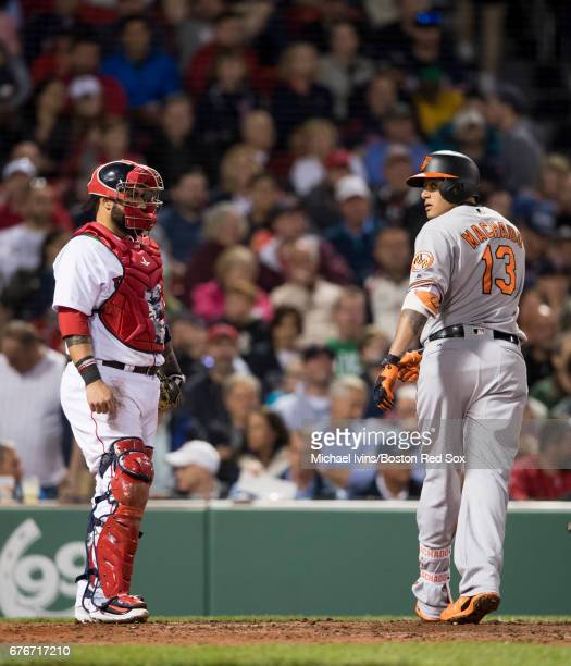 Manny Machado of the Baltimore Orioles looks back towards the home dugout after hitting a home run against the Boston Red Sox in the seventh inning...