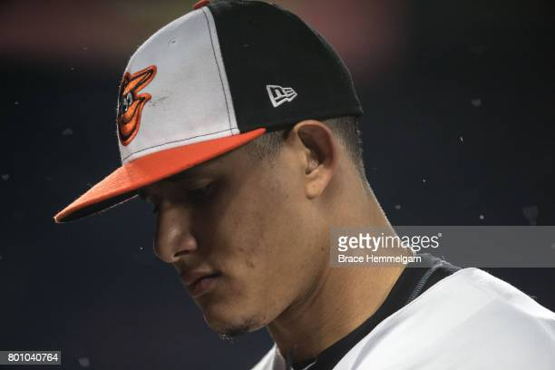 Manny Machado of the Baltimore Orioles looks on against the Minnesota Twins on May 23 2017 at Oriole Park at Camden Yards in Baltimore Maryland The...