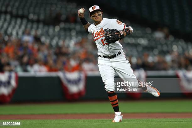 Manny Machado of the Baltimore Orioles makes a play on a hit by Russell Martin of the Toronto Blue Jays during the second inning at Oriole Park at...