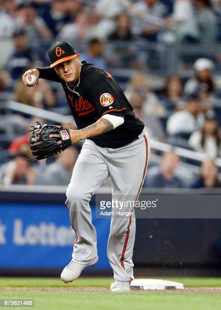 Manny Machado of the Baltimore Orioles makes a throw against the New York Yankees at Yankee Stadium on April 28 2017 in the Bronx borough of New York...