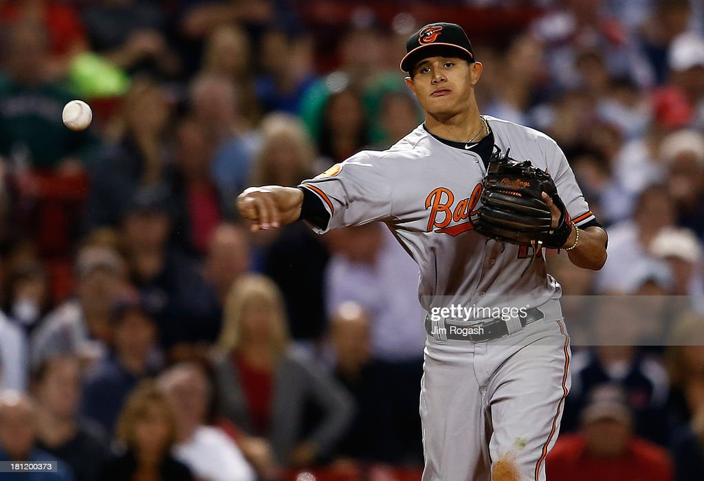 <a gi-track='captionPersonalityLinkClicked' href=/galleries/search?phrase=Manny+Machado&family=editorial&specificpeople=5591039 ng-click='$event.stopPropagation()'>Manny Machado</a> #13 of the Baltimore Orioles makes the assist against the Boston Red So in the 7th inning at Fenway Park on September 19, 2013 in Boston, Massachusetts.