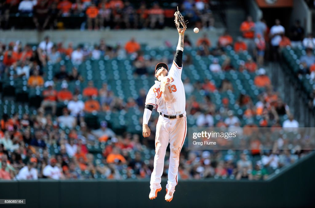 Manny Machado #13 of the Baltimore Orioles misses a ball off the bat of Boog Powell #3 (not pictured) of the Oakland Athletics in the sixth inning at Oriole Park at Camden Yards on August 23, 2017 in Baltimore, Maryland.