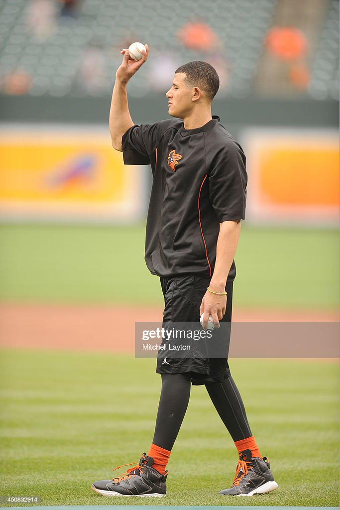 Manny Machado #13 of the Baltimore Orioles on the field before a baseball game against the Boston Red Sox on June 11, 2014 at Oriole Park at Camden Yards in Baltimore, Maryland. The Orioles won 6-0.
