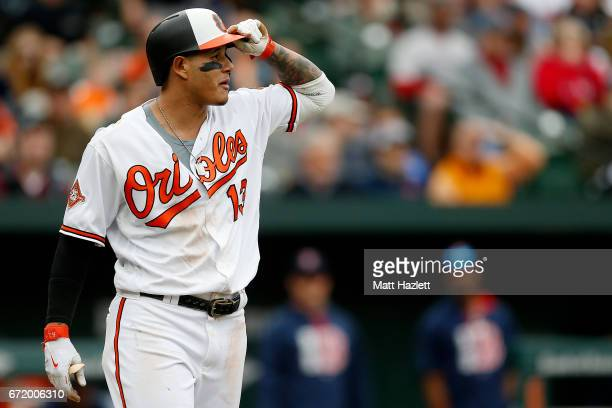 Manny Machado of the Baltimore Orioles reacts after a wild pitch thrown by Matt Barnes of the Boston Red Sox in the eighth inning at Oriole Park at...