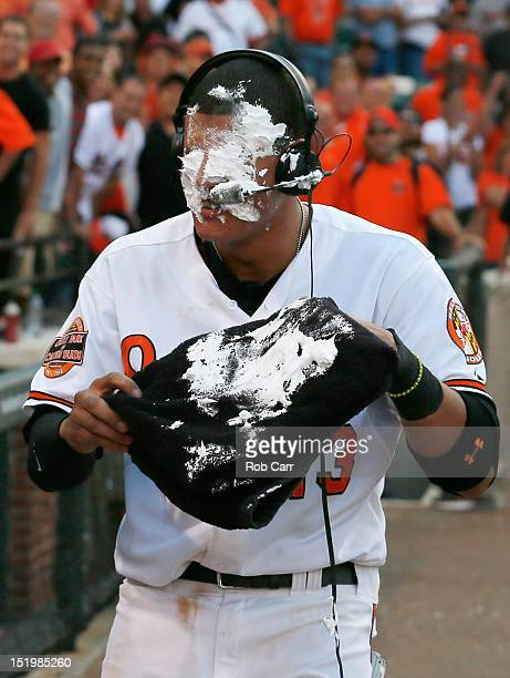 Manny Machado of the Baltimore Orioles reacts after getting hit with a shaving cream pie after the Orioles defeated the Tampa Bay Rays 32 in fourteen...