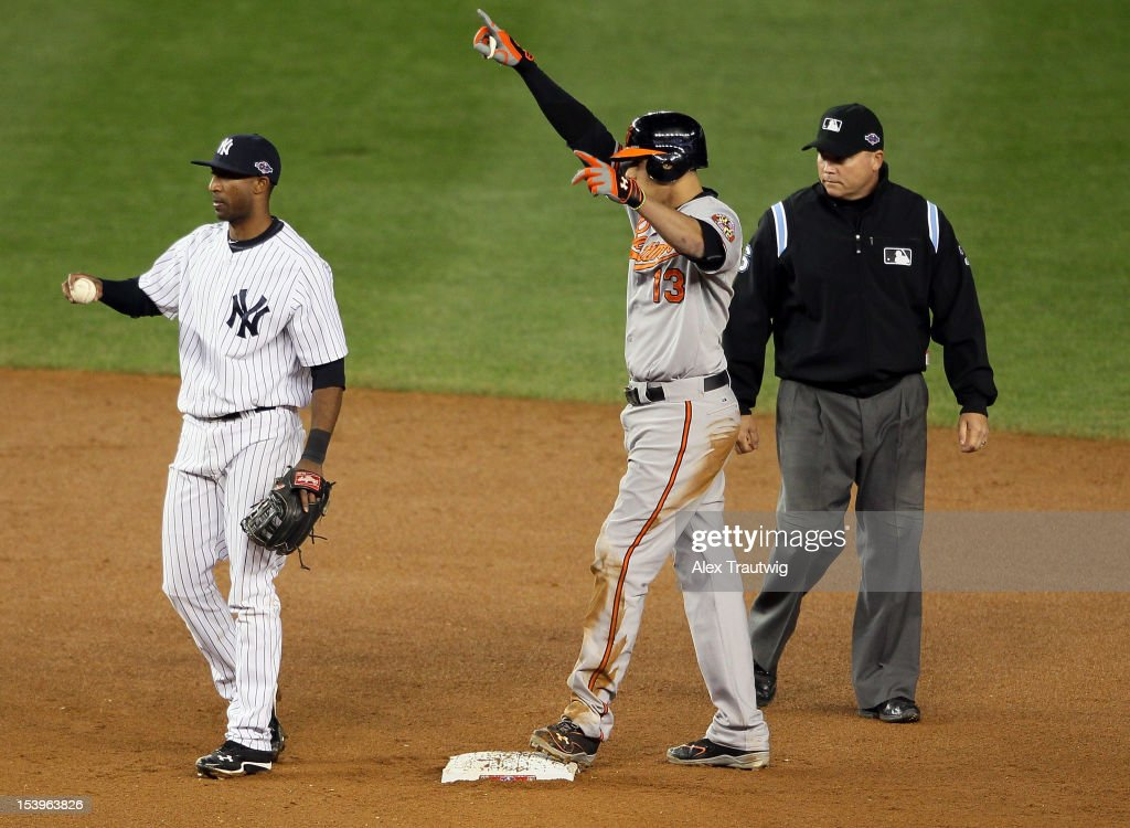 Manny Machado #13 of the Baltimore Orioles reacts after getting on base in the thirteenth inning of Game Four of the American League Division Series at Yankee Stadium on October 11, 2012 in the Bronx borough of New York City.