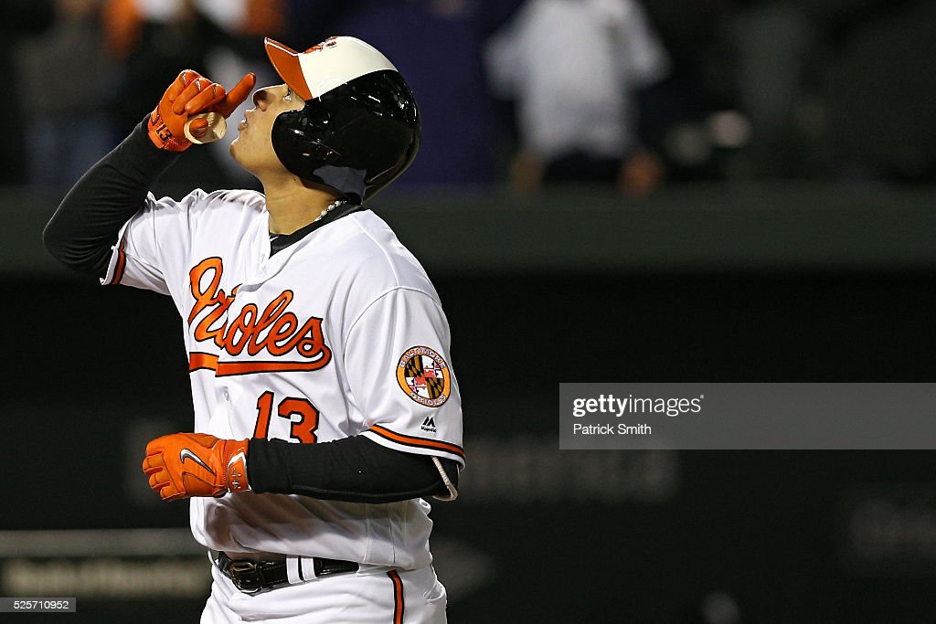 <a gi-track='captionPersonalityLinkClicked' href=/galleries/search?phrase=Manny+Machado&family=editorial&specificpeople=5591039 ng-click='$event.stopPropagation()'>Manny Machado</a> #13 of the Baltimore Orioles reacts after hitting a grand slam home run against the Chicago White Sox in the sixth inning at Oriole Park at Camden Yards on April 28, 2016 in Baltimore, Maryland.
