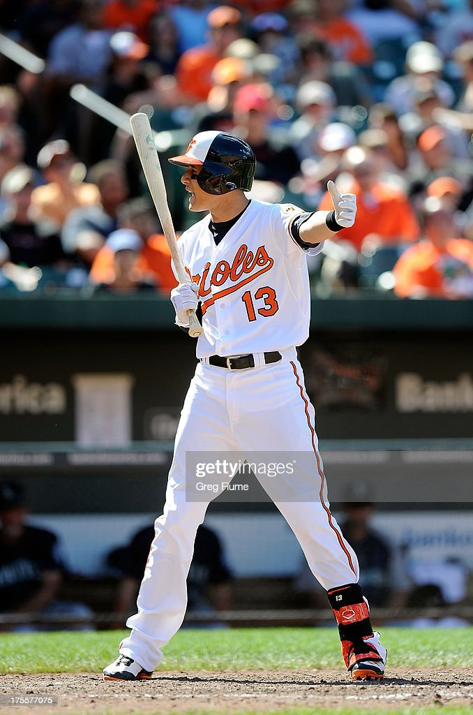 <a gi-track='captionPersonalityLinkClicked' href=/galleries/search?phrase=Manny+Machado&family=editorial&specificpeople=5591039 ng-click='$event.stopPropagation()'>Manny Machado</a> #13 of the Baltimore Orioles reacts after striking out in the seventh inning against the Seattle Mariners at Oriole Park at Camden Yards on August 4, 2013 in Baltimore, Maryland.